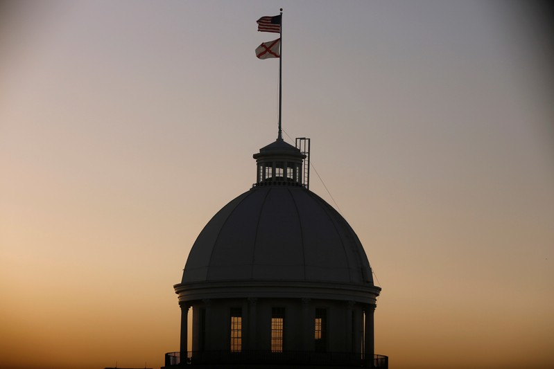 The U.S. Flag and Alabama State Flag fly over the Alabama Governor's Mansion as the state Senate votes on the strictest anti-abortionbill in the United States at the Alabama Legislature in Montgomery