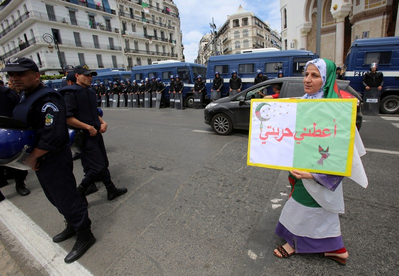 A demonstrator carries a banner during an anti-government protest in Algiers