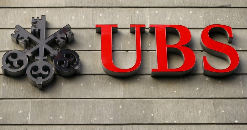 FILE PHOTO: The logo of Swiss bank UBS at an office building in Zurich
