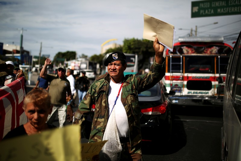 FILE PHOTO: Civil war veterans protest during the commemoration of the 26th anniversary of the signing of the peace accords in San Salvador