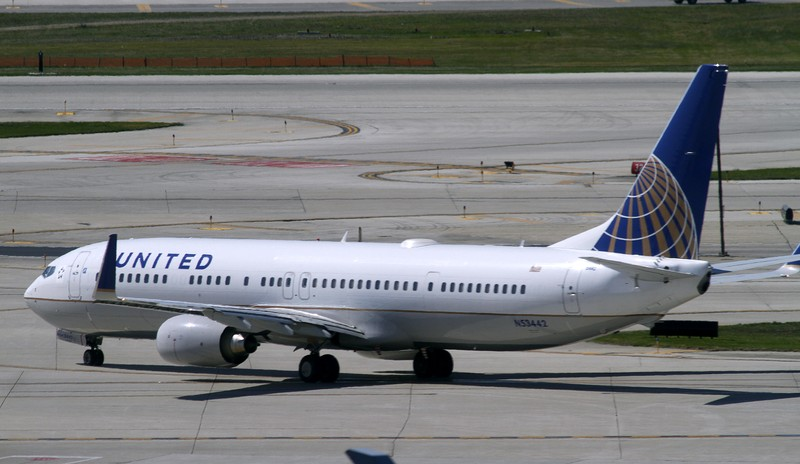 FILE PHOTO: A United Airlines plane with the Continental Airlines logo on its tail, taxis to the runway at O'Hare International airport in Chicago