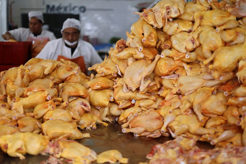FILE PHOTO: Butchers cut up chickens in a butcher shop in downtown Mexico City