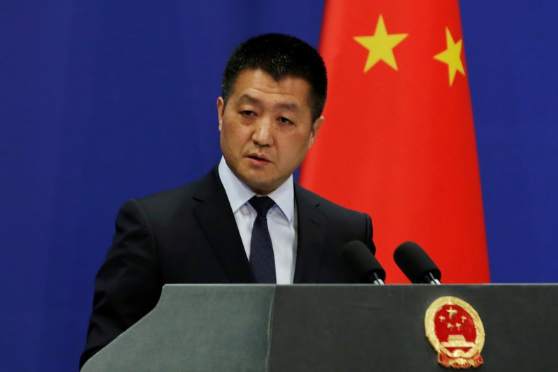 Chinese Foreign Ministry spokesman Lu Kang answers questions about a major bus accident in North Korea, during a news conference in Beijing