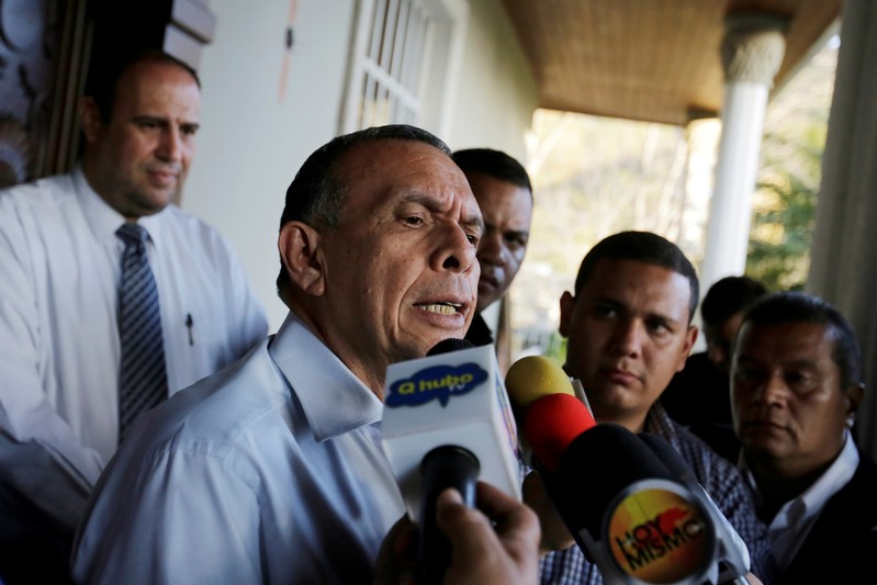FILE PHOTO: Former Honduran president Porfirio Lobo holds a news conference at his house following accusations by the National Anti-corruption Council of embezzlement during his government, in Tegucigalpa