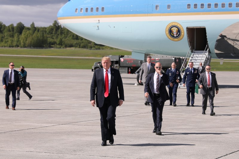 U.S. President Trump arrives aboard Air Force One during a refueling stop on his way to Japan at Joint Base Elmendorf, Alaska