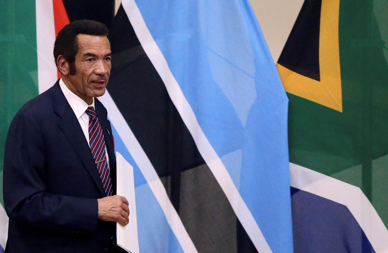 FILE PHOTO: Botswana's President Ian Khama returns to his seat after giving a speech during the Botswana-South Africa Bi-National Commission (BNC) in Pretoria