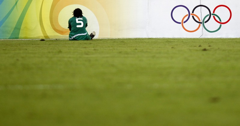 Nigeria's Onome Ebi sits on the pitch during their women's first-round group F soccer match against Brazil at the Beijing 2008 Olympic Games