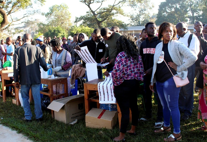 FILE PHOTO: Voters queue to cast their ballots in Malawi's presidential and legislative elections, in Lilongwe