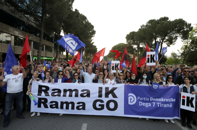 Supporters of the opposition party attend an anti-government protest in Tirana