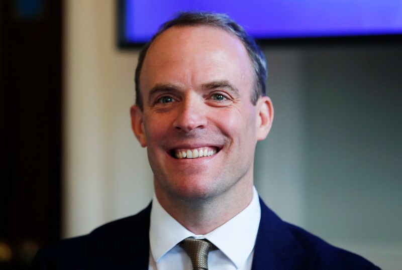 FILE PHOTO: Dominic Raab attends