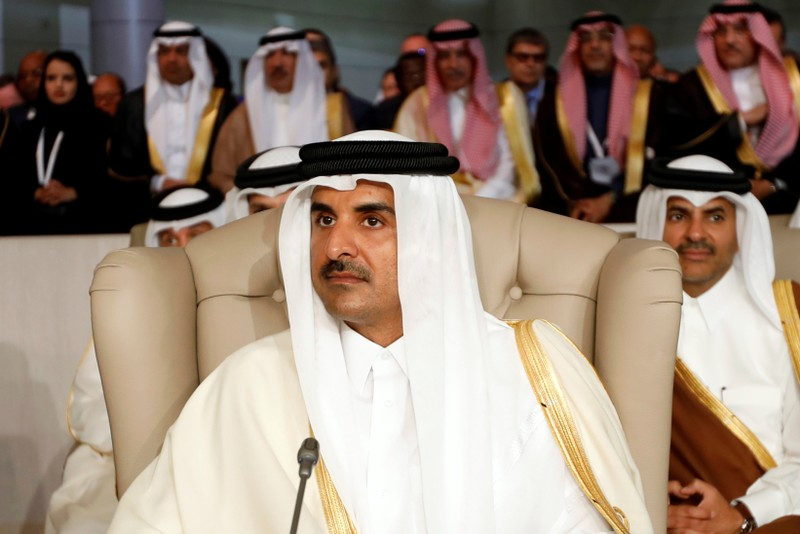FILE PHOTO: Qatar's Emir Sheikh Tamim bin Hamad Al-Thani attends the 30th Arab Summit in Tunis