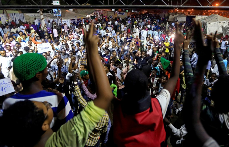 FILE PHOTO: Sudanese protesters attend a demonstration along the streets of Khartoum