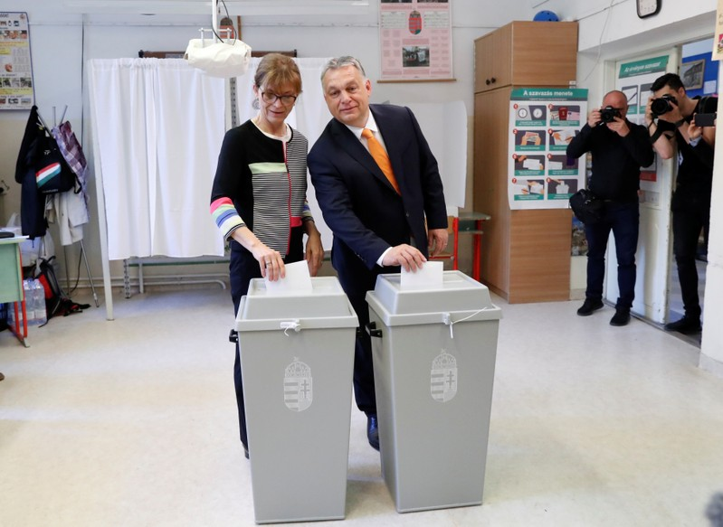 Hungarian Prime Minister Viktor Orban and his wife Aniko Levai cast their ballots during the European Parliament Elections in Budapest