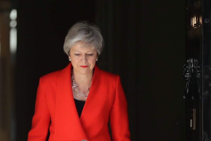 British Prime Minister Theresa May arrives to deliver a statement in London
