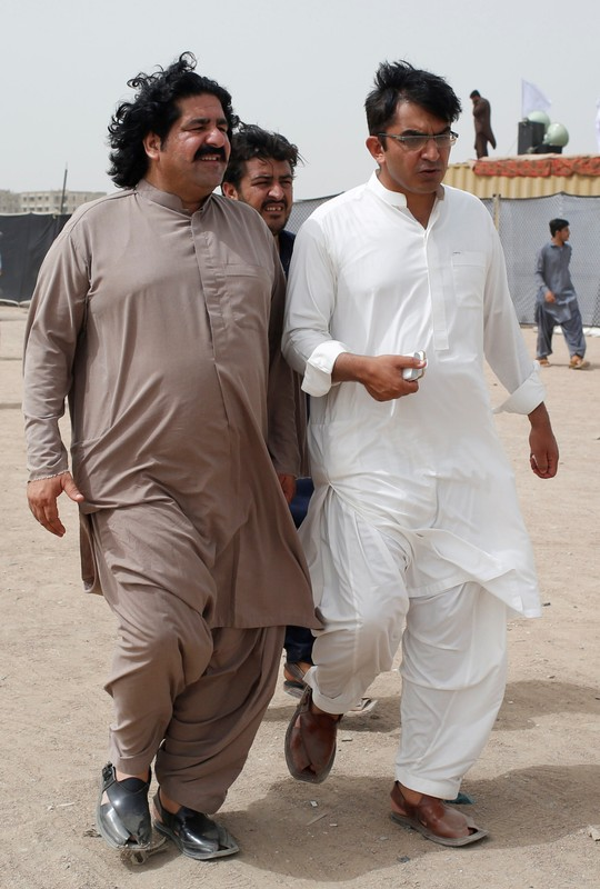 FILE PHOTO: Ali Wazir and Mohsin Dawar PTM leaders walk at the venue of the rally in Karachi