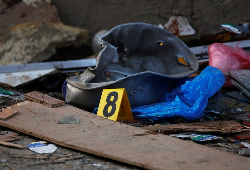 Police numbering is seen on an explosion site in Kathmandu