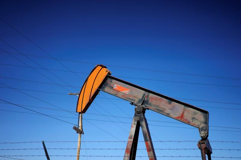 FILE PHOTO: An oil well pump jack is seen at an oil field supply yard near Denver