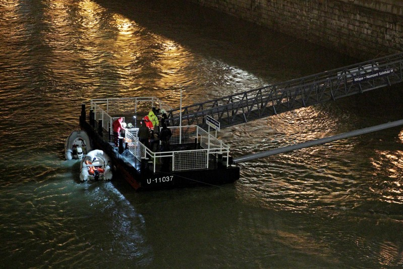 A rescue boat is seen on the Danube river after a tourist boat capsized in Budapest