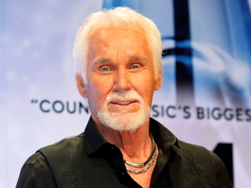 FILE PHOTO: Kenny Rogers poses backstage after accepting the Willie Nelson Lifetime Achievement award at the 47th Country Music Association Awards in Nashville