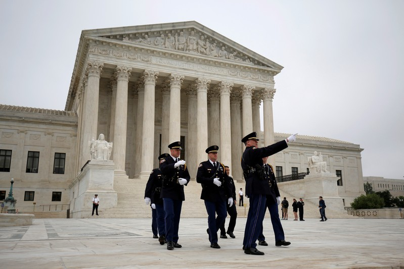 FILE PHOTO: Police officers walk on the plaza of the Supreme Court in Washington