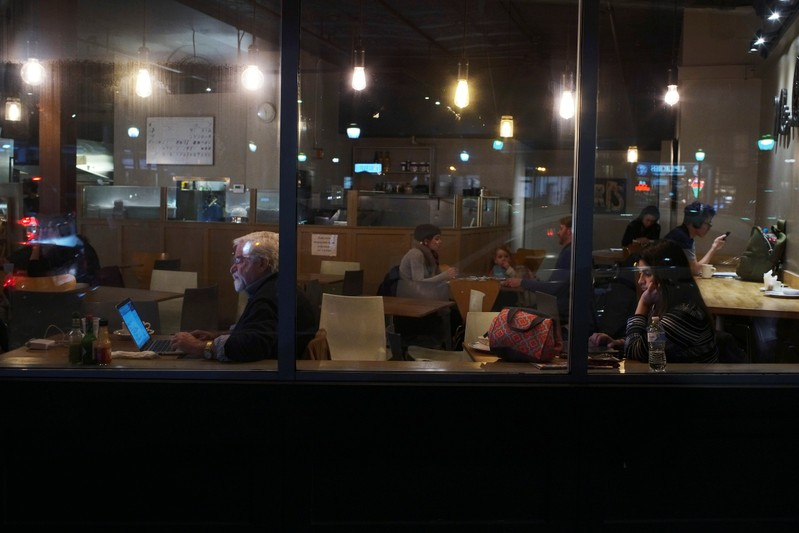 Customers sit in a crepe restaurant in Somerville