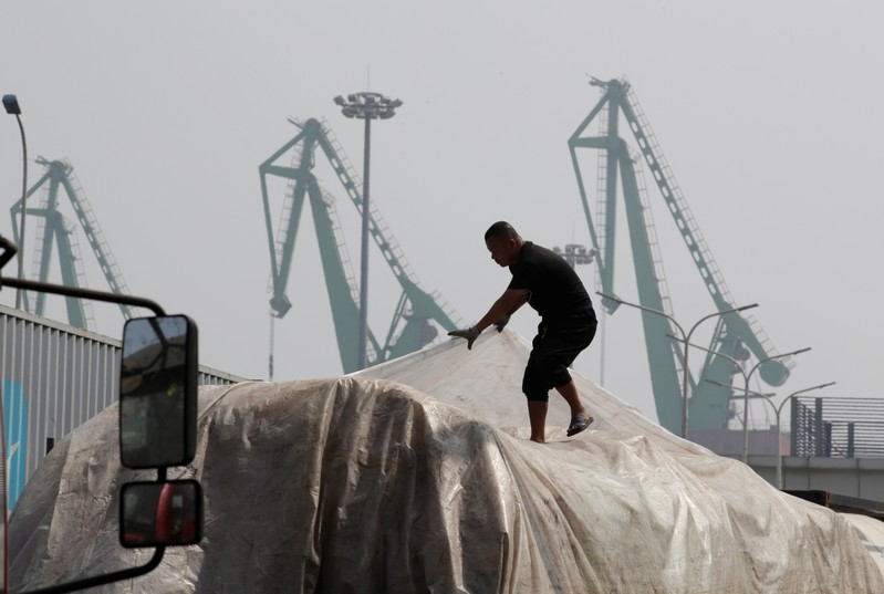 A labourer works outside a logistics center near Tianjin Port