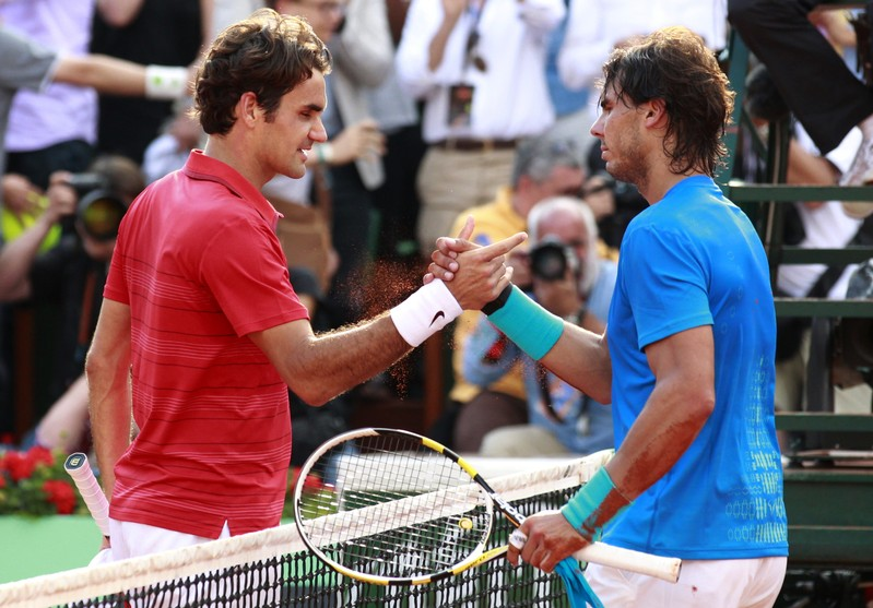 FILE PHOTO - Nadal of Spain shakes hands with Federer of Switzerland after winning their men's final at the French Open tennis tournament at the Roland Garros stadium in Paris