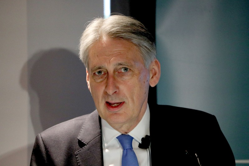 Chancellor of the Exchequer Philip Hammond speaks at the launch of a report, by living standards think tank the Resolution Foundation, on the impact of the higher minimum wage at the Resolution Foundation offices in London