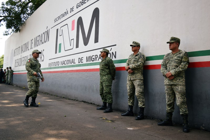 Soldiers assigned to the newly created National Guard keep watch outside the Siglo XXI immigrant detention center as part of the security measures by the federal government, in Tapachula