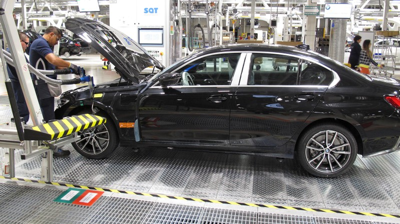 Employees work on a BMW 3 Series car during a media tour at the new plant of German automaker BMW in San Luis Potosi