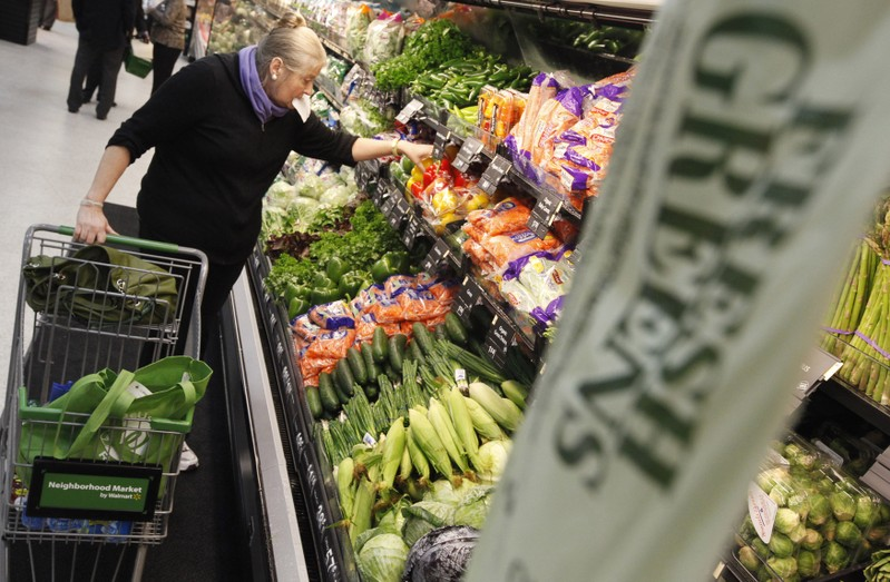 A shopper looks through the produce section in a newly opened Walmart Neighborhood Market in Chicago