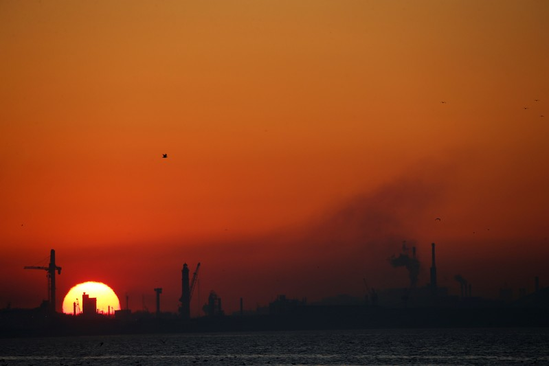 Dunkirk port industries are seen during sunset, in Leffrinckouke