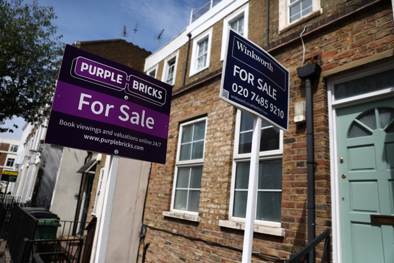 Estate agent boards are displayed outside a property in London