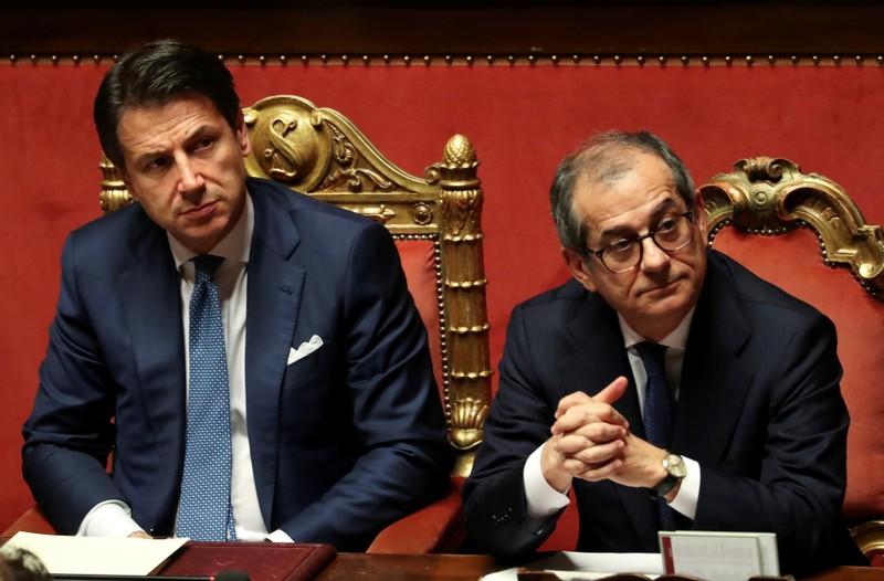FILE PHOTO: Italian Prime Minister Giuseppe Conte and Italian Economy Minister Giovanni Tria attend a debate at the Senate in Rome