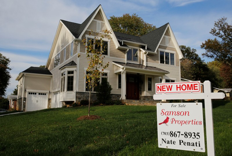 FILE PHOTO - A real estate sign advertising a new home for sale is pictured in Vienna, Virginia