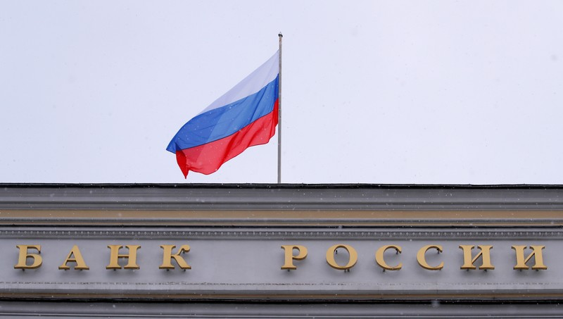 A Russian flag flies over Russian Central Bank headquarters in Moscow