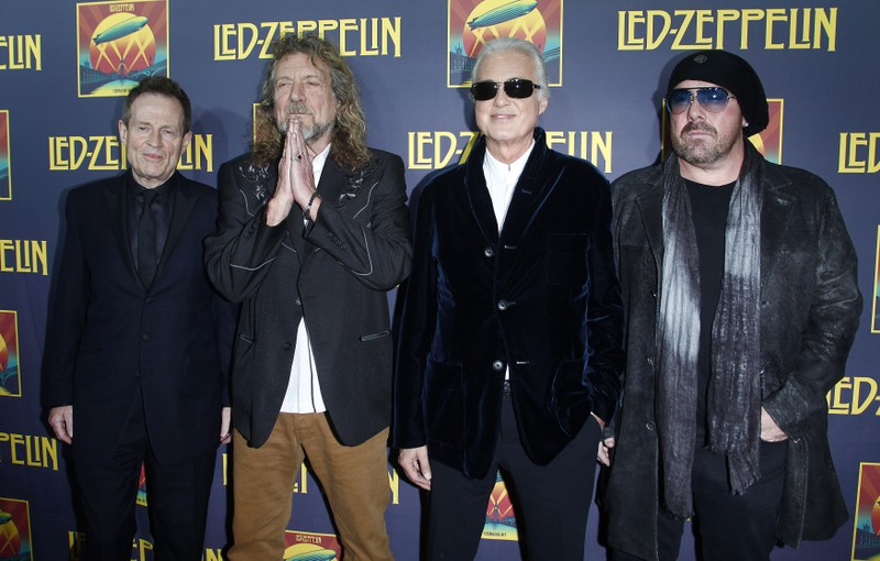 FILE PHOTO - Members of British rock band Led Zeppelin bass player Jones, lead singer Plant, guitarist Page and drummer Bonham arrive for the premiere of their film