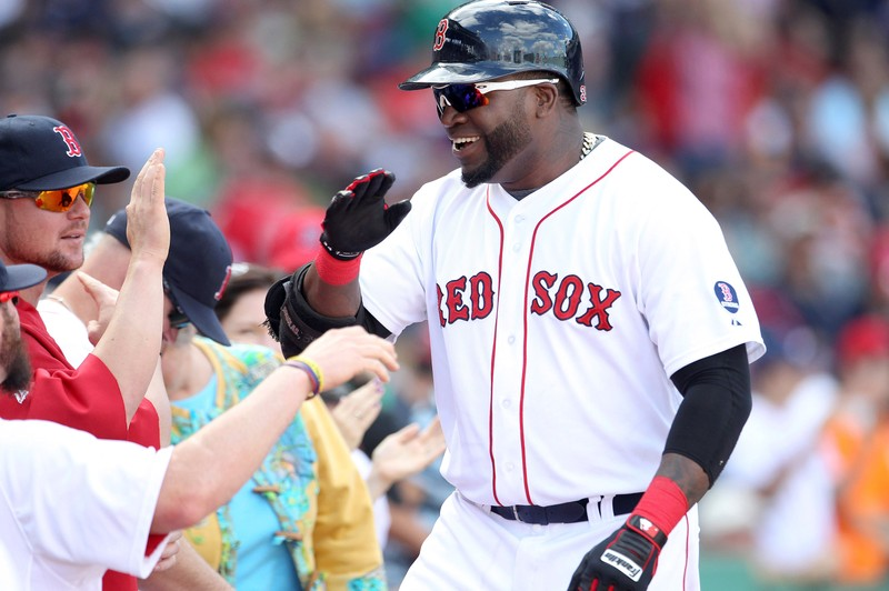 FILE PHOTO: Boston Red Sox designated hitter David Ortiz celebrates his solo home in the sixth inning against the Toronto Blue Jays during their MLB American League East baseball game in Boston