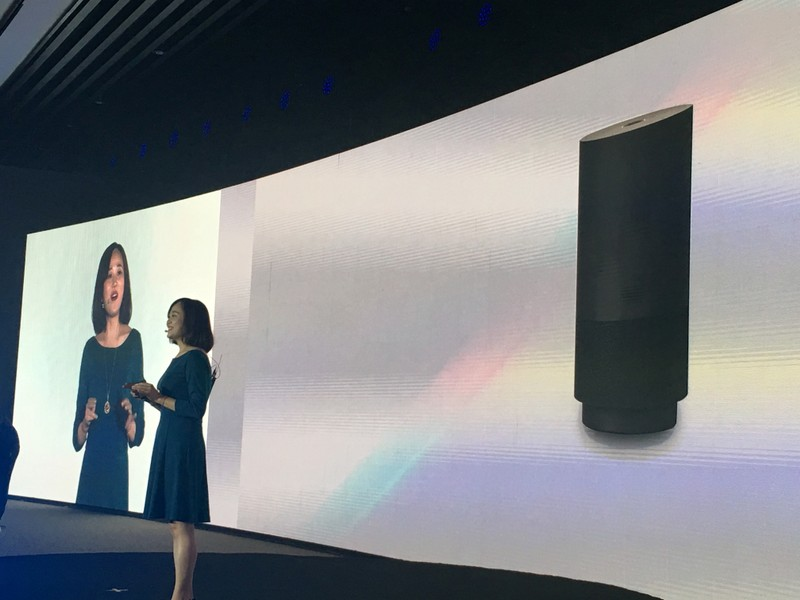 A member of staff from Alibaba Group introduces the company's newly released cut-price voice assistant speaker Tmall Genie during a press conference in Beijing