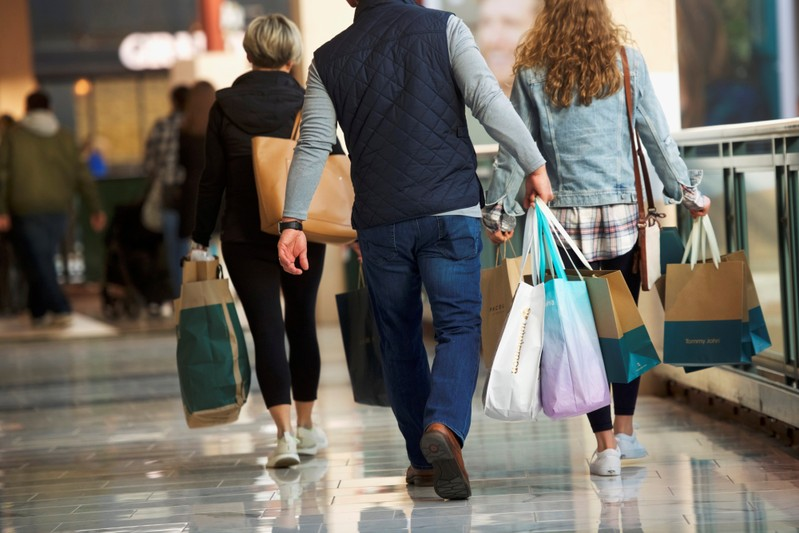 Shoppers carry bags of purchased merchandise at the King of Prussia Mall, United States' largest retail shopping space, in King of Prussia
