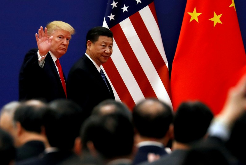 FILE PHOTO: U.S. President Donald Trump and China's President Xi Jinping meet business leaders at the Great Hall of the People in Beijing
