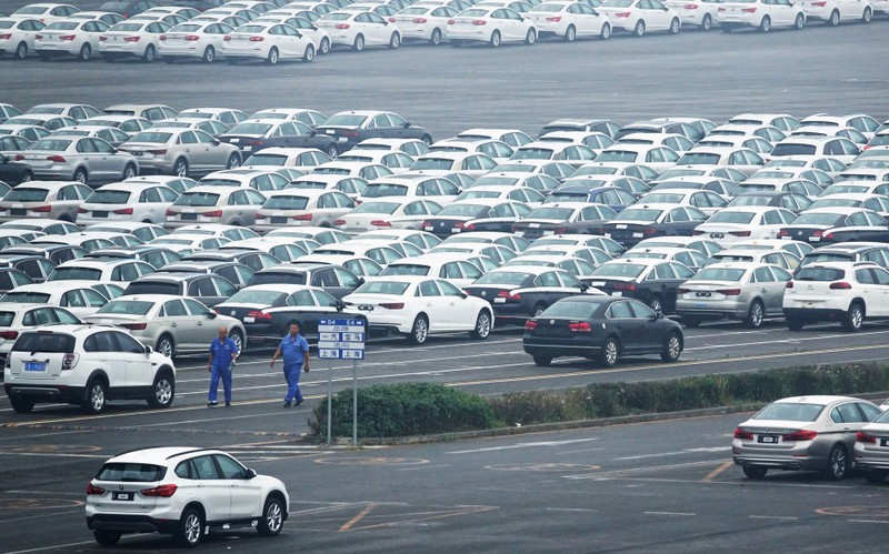 FILE PHOTO: Newly manufactured cars are seen at the automobile terminal in the port of Dalian, Liaoning