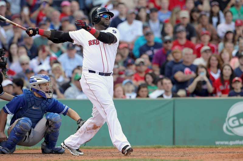 FILE PHOTO: Boston Red Sox appointed hitter Ortiz follows through as he flies out in eighth inning against Toronto Blue Jays during their MLB American League East baseball game in Boston