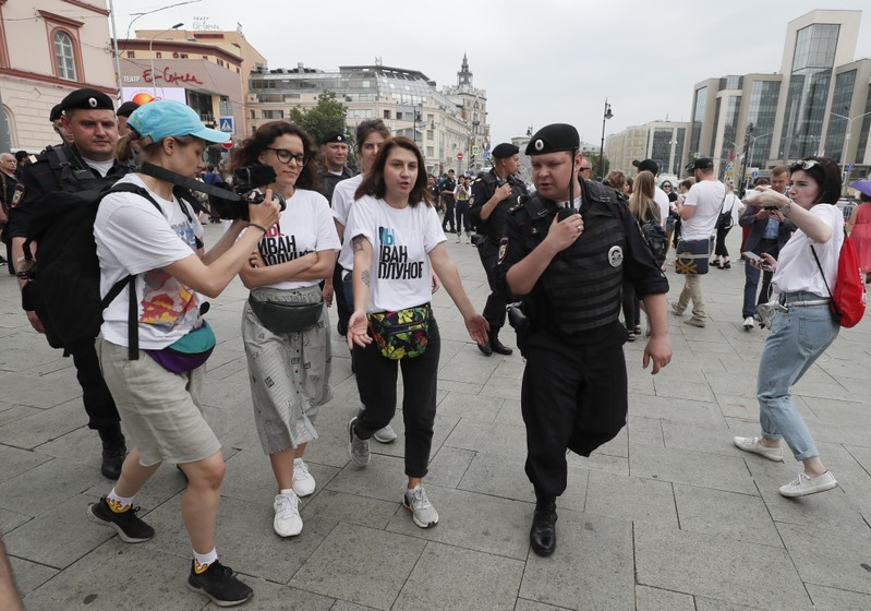 Policemen escort participants of a rally in support of Russian investigative journalist Ivan Golunov in Moscow