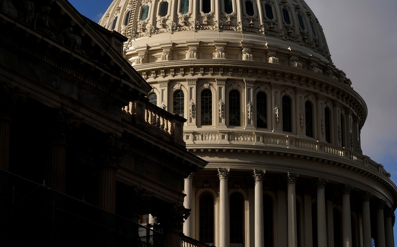 FILE PHOTO: Sun shines on the U.S. Capitol Dome as budget legislation deadlines loom for a potential federal government shutdown in Washington