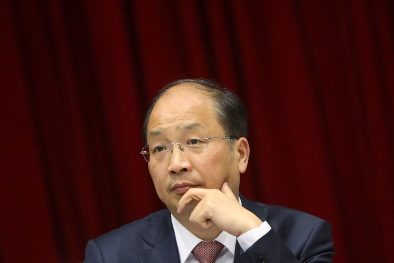 Yi Huiman, chairman of China Securities Regulatory Commission, attends a meeting of Fujian delegation on the sidelines of the National People's Congress (NPC), at the Great Hall of the People in Beijing