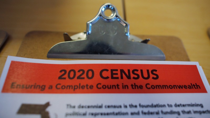 An informational pamphlet is displayed at an event for community activists and local government leaders to mark the one-year-out launch of the 2020 Census efforts in Boston