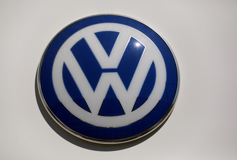 FILE PHOTO: The logo of Volkswagen carmaker is seen at the entrance of a showroom in Nice