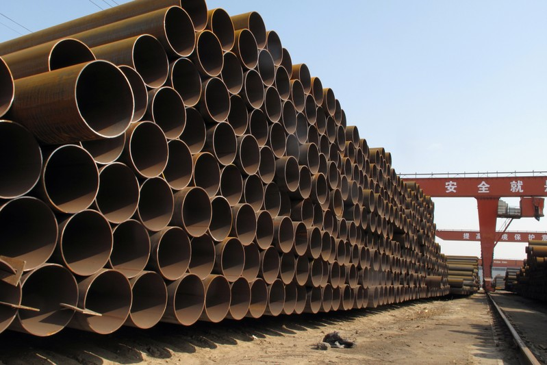 Steel pipes waiting to be loaded and transferred to the port are seen at a steel mill in Cangzhou