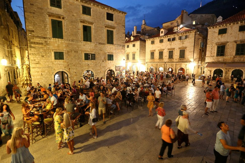 FILE PHOTO: People are seen in a coffee shop in Dubrovnik